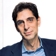 headshot of Gianni Giacomelli at Genpact